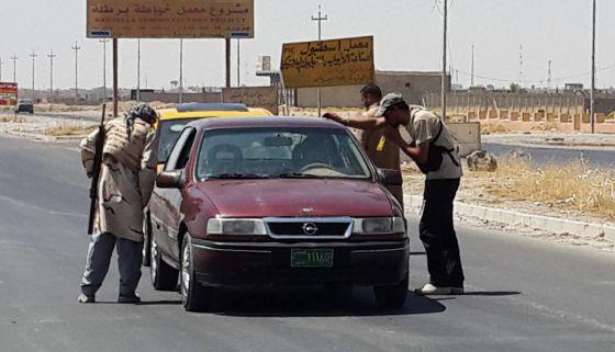 Milicianos do Estado Islâmico, no norte do Iraque.