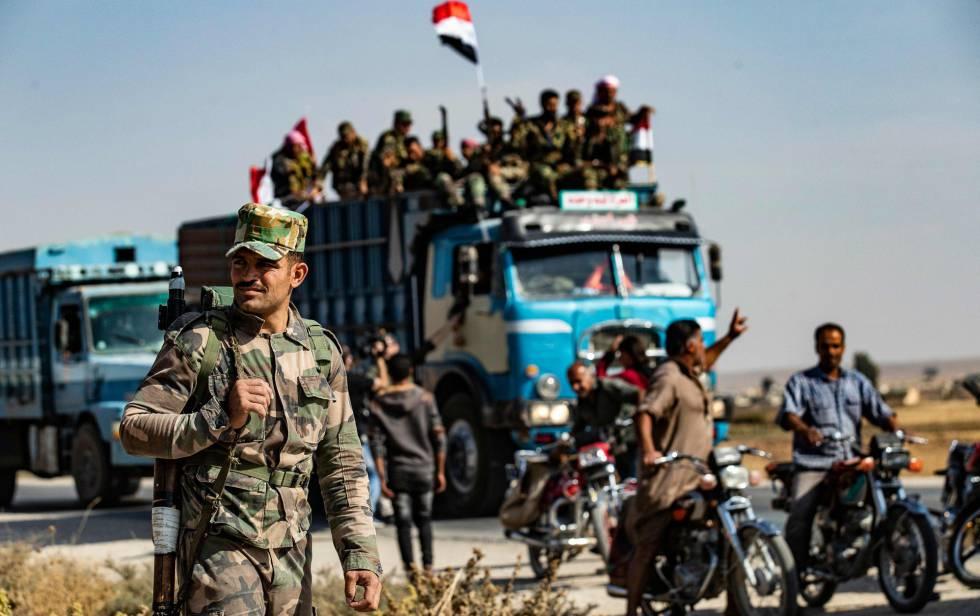 Forças governamentais sírias chegam nesta terça-feira a Tal Tamr, perto de Ras al Ain.