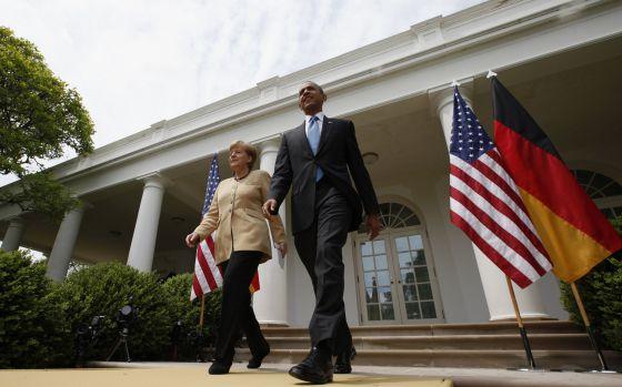 Merkel e Obama nos jardins da Casa Branca.