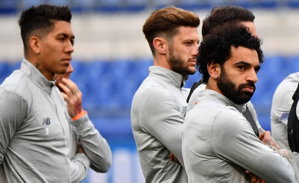 Os jogadores do Liverpool se preparam para o jogo contra a Roma.