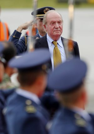 Juan Carlos arrives in Bogota to attend the inauguration of President Juan Manuel Santos.