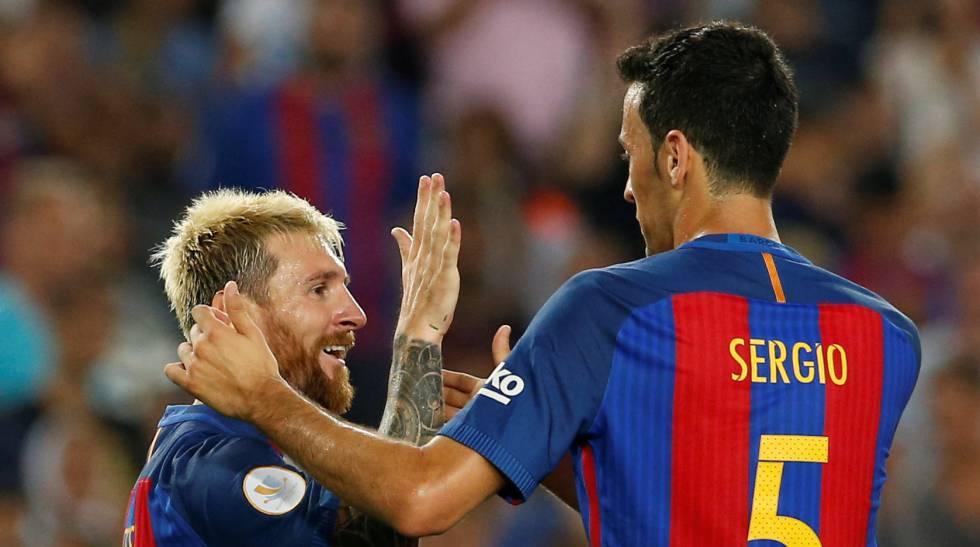 Busquets, com Messi.