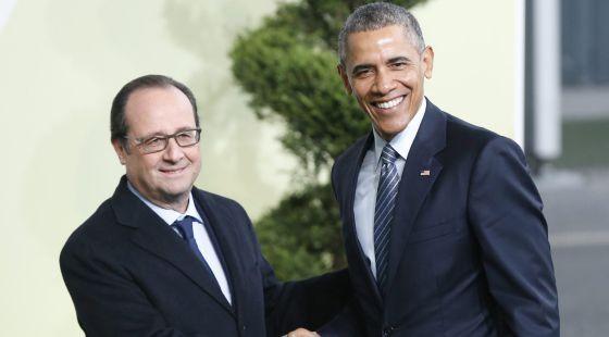 O presidente francês, François Hollande, recebe o presidente dos EUA, Barack Obama, na cúpula de Paris em 30 de novembro.