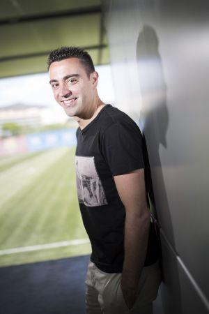 Xavi posa no campo Tito Vilanova.