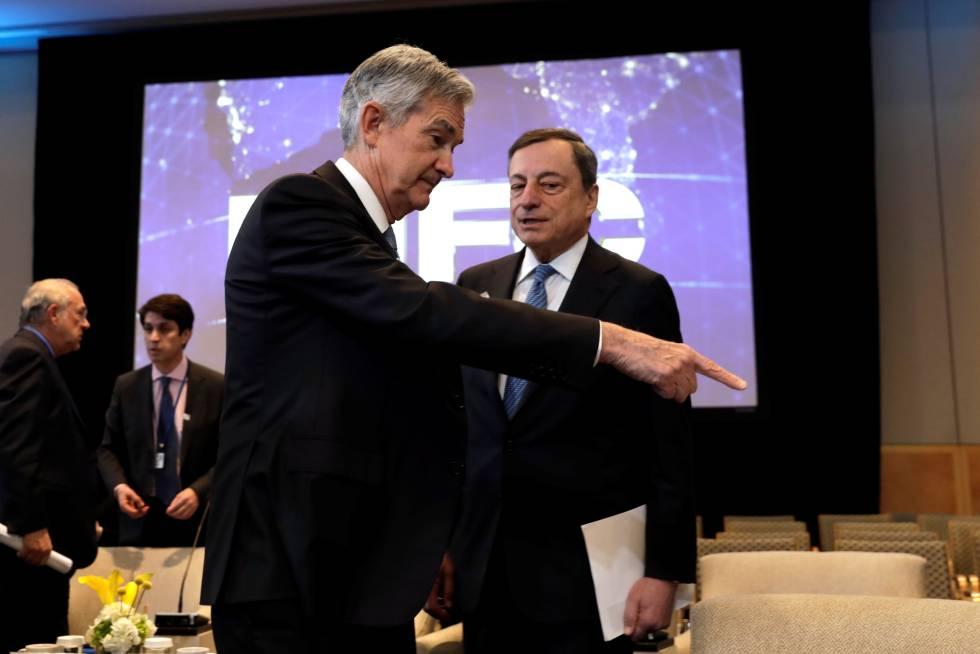 Jerome Powell, presidente da Reserva Federal, e Mario Draghi, presidente do BCE.