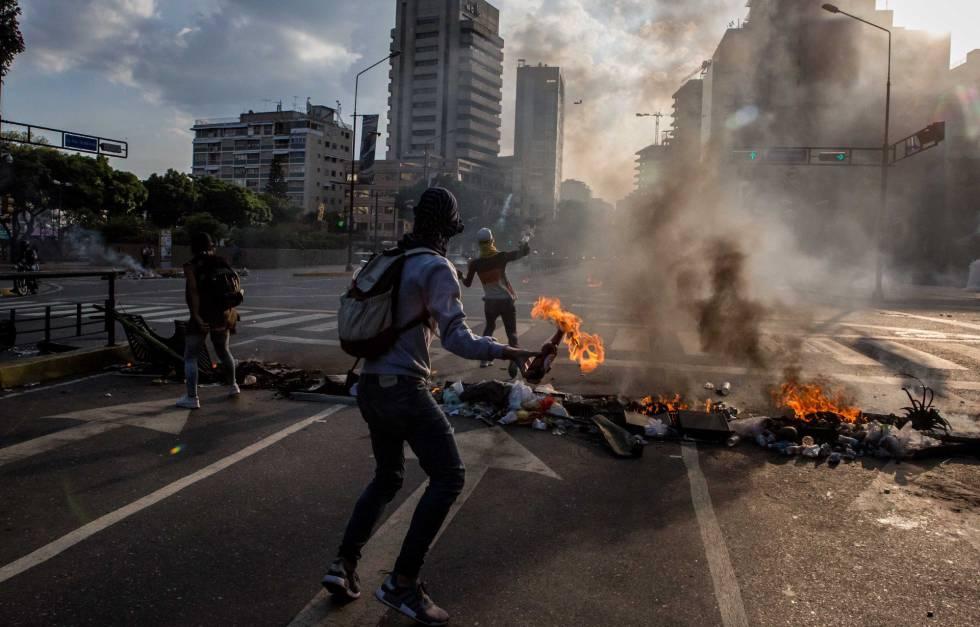 Confrontos entre opositores e chavistas, no sábado passado.