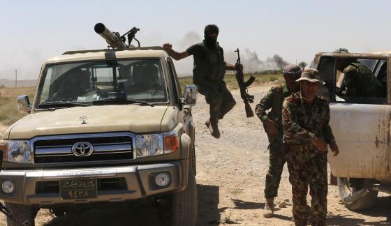Combatentes curdos em Buyuk Yeniga, Iraque.