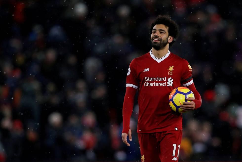 Salah celebra seus quatro gols e a vitória por 5 a 0 contra o Watford.