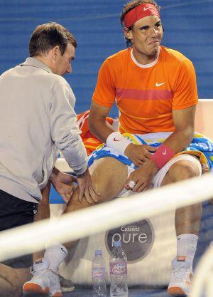 Rafael Nadal receives treatment on his knee during the 2010 Australia Open.