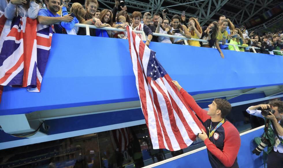 Phelps, a bandeira dos EUA e seu bebê, Boomer.