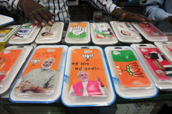 Capa de celulares com os candidatos e os símbolos dos partidos.
