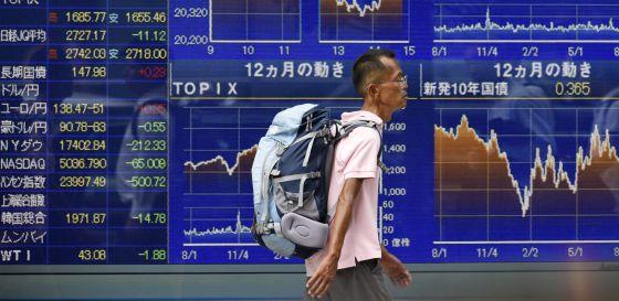 Tela com informações do mercado de ações em Tóquio, nesta quarta.