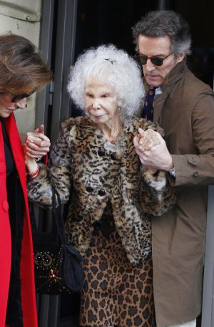 The Duchess of Alba leaves a Madrid restaurant with husband Alfonso Díez.